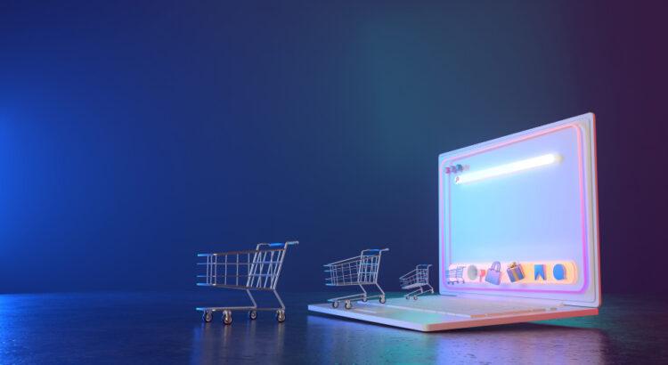 Carrinho de compras em cima de um notebook - plataforma Magento